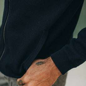 fit model wearing portola hoodie, thumb in pocket