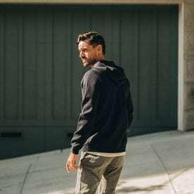 fit model wearing portola hoodie, looking back