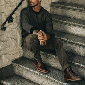 fit model wearing The Slim All Day Pant in Espresso Cord, sitting on steps