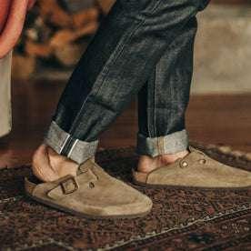 fit model wearing The Slim Jean in Nihon Menpu Selvage, cuffed with birks