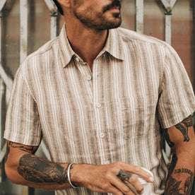 fit model wearing The Short Sleeve California in Desert Shadow Stripe, looking right