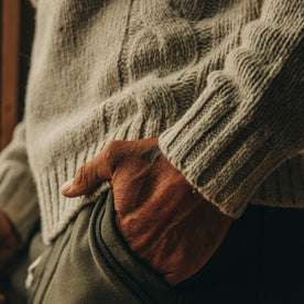 fit model wearing The Topside Sweater in Natural Cable Knit, hand in pocket