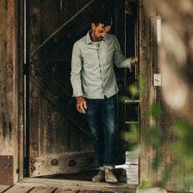 fit model wearing The Western Shirt in Washed Denim, walking through door