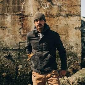 fit model wearing The Workhorse Jacket in Coal Boss Duck, hand in pocket