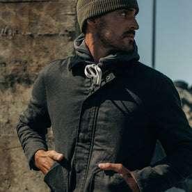 fit model wearing The Workhorse Jacket in Coal Boss Duck, looking right