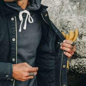 fit model wearing The Workhorse Jacket in Coal Boss Duck, pocket detail