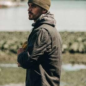 fit model wearing The Workhorse Jacket in Coal Boss Duck, looking left