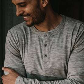 fit model wearing The Merino Henley, smiling