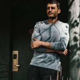 fit model wearing The Merino Henley, arms crossed