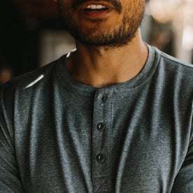 fit model wearing The Merino Henley, chest detail