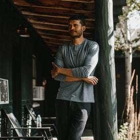 fit model wearing The Merino Henley, looking left outside
