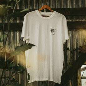 material shot of The Cotton Hemp Tee in Natural Give to Get, hanging