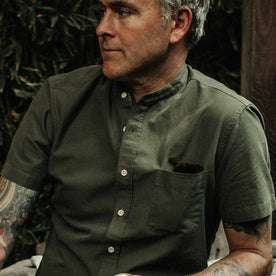 out fit model wearing The Short Sleeve Bandit in Olive, looking right