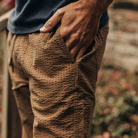 our fit model wearing The Après Pant in British Khaki Seersucker—cropped shot, hand in pocket