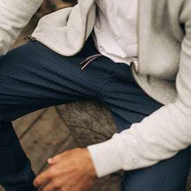 our fit model wearing The Après Pant in Navy Seersucker—cropped shot, sitting down