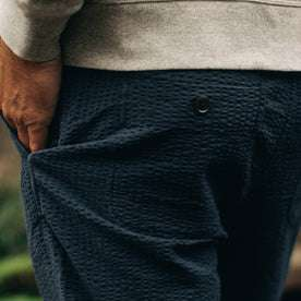 our fit model wearing The Après Pant in Navy Seersucker—cropped shot of pant back