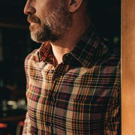 our fit model wearing The California in Vintage Navy Madras—looking left