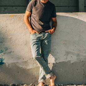 our fit model wearing The Democratic Jean in 24-Month Wash Japanese Selvage—hands in pockets, cropped shot