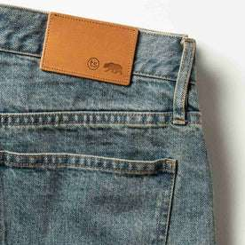 material shot of The Democratic Jean in 24-Month Wash Japanese Selvage—leather patch closeup