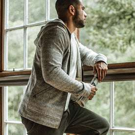 our fit model wearing The Après Hoodie in Heather Grey