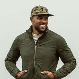 our fit model wearing The Ball Cap in Arid Camo