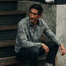 fit model wearing The California in Navy Salt and Pepper Plaid, sitting on stairs
