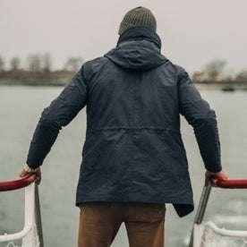 fit model wearing The Dalton Jacket in Navy on a ferry, back shot