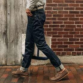 fit model wearing The Democratic Jean in Organic Selvage, walking down street