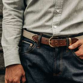 fit model wearing The Democratic Jean in Organic Selvage, cropped waist shot