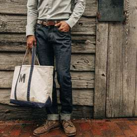 fit model wearing The Democratic Jean in Organic Selvage, cuffed, hand in pocket
