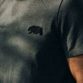 fit model wearingThe Embroidered Heavy Bag Tee in Grey Bear, chest detail