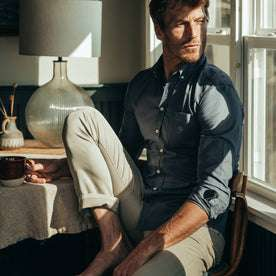 fit model wearing The Jack in Ocean Oxford, sitting at table, drinking coffee