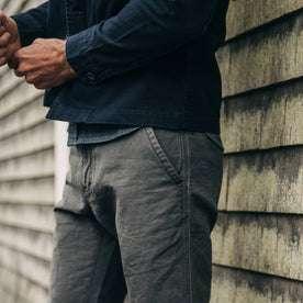 fit model wearing The Morse Pant in Charcoal Slub Linen, side shot
