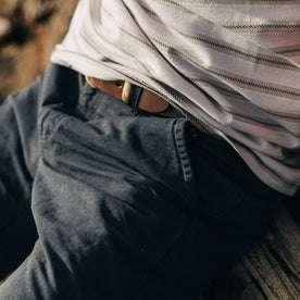 fit model wearing The Morse Pant in Navy Slub Linen, close up of pocket exterior