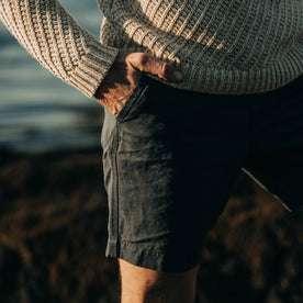 fit model wearing The Morse Short in Navy Slub Linen, hand in pocket, close up
