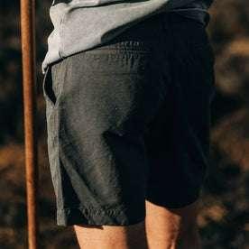 fit model wearing The Morse Short in Navy Slub Linen, back detail