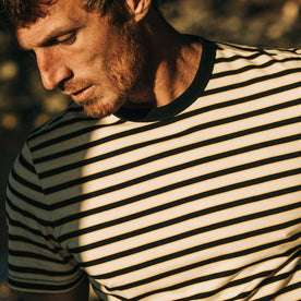 fit model wearing The Organic Cotton Tee in Gold Stripe, chest crop