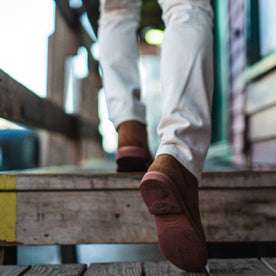 fit model wearing The Trench Boot in Butterscotch Weatherproof Suede, walking up stairs