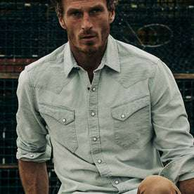 fit model wearing The Western Shirt in Washed Selvage Chambray, cropped shot forehead down