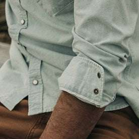 fit model wearing The Western Shirt in Washed Selvage Chambray, cuffed sleeve detail