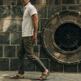 fit model wearing The Democratic All Day Pant in Olive Bedford Cord, walking left