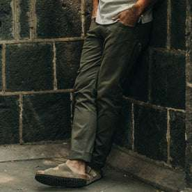 fit model wearing The Democratic All Day Pant in Olive Bedford Cord, hands in pockets