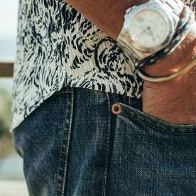 fit model wearing The Democratic Jean in Organic Selvage 12-month Wash, side shot up close