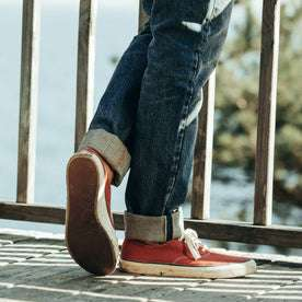 fit model wearing The Democratic Jean in Organic Selvage 12-month Wash, cuffed over shoes