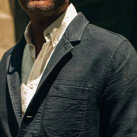 fit model wearing The Emerson Jacket in Navy Double Cloth, chest detail