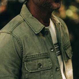 fit model wearing The HBT Jacket in Washed Olive, chest detail