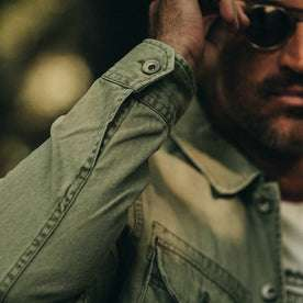 fit model wearing The HBT Jacket in Washed Olive, sleeve detail
