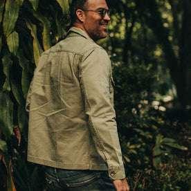 fit model wearing The HBT Jacket in Washed Olive, side profile, smiling
