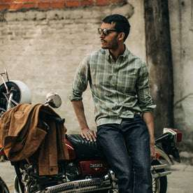 fit model wearing The Jack in Moss Plaid, sitting on motorcycle