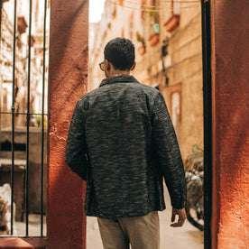 fit model wearing The Ojai Jacket in Black Cross Dye, back shot
